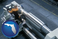 florida map icon and steel fabrication on an automated lathe