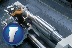 vermont map icon and steel fabrication on an automated lathe