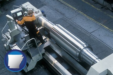steel fabrication on an automated lathe - with Arkansas icon